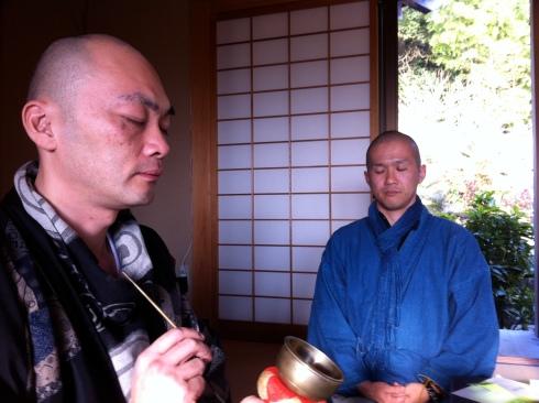 Rev. Nemoto (left) leads meditation at a death workshop at his temple