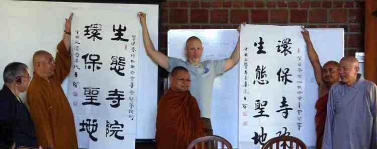"""In Chinese characters: """"Protecting the Sacred Land Eco-Temple"""". Ven. Master Ren Da (left) & Ven. Miao Hai (right) at the eco-temple meeting in Sri Lanka 2016"""
