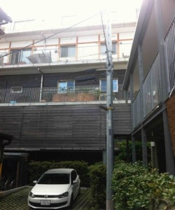 Kenju-in apartments with an outer wall of burnt cedar for non-chemical, external insulation