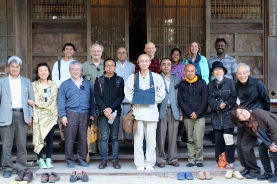 Participants at Dokei-ji Temple with Abbot Toku-un Tanaka inside the evacuation zone