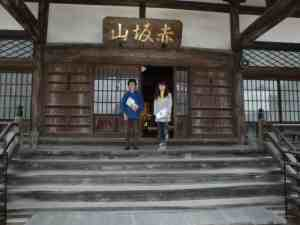 Rev. Sasaki and his wife in fron of the main hall of Shingyo-ji temple
