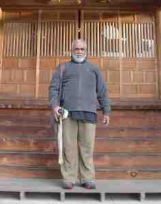 Harsha Navaratne on the step of Senrin-ji Temple in Da-te City, about 55 kms from the Fukushima #1 Nuclear Complex