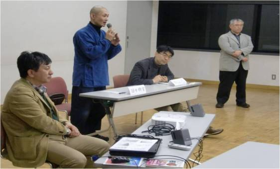 Rev. Tanaka (center) giving this talk at a meeting of the Interfaith Forum for the Review of National Nuclear Policy in Tokyo January 2012 with Forum leaders Rev. Noda (Lutheran), Rev. Okayama (Jodo Shin) and Rev. Okochi (Jodo).